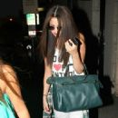 Selena Gomez got her hair chemically straightened today at a hair salon in West Hollywood, California on July 19, 2013 - 454 x 602