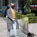 Lili Reinhart – Dons Converse sneakers as she takes dog Milo out for a walk in Vancouver - 454 x 568