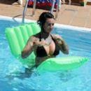 Jemma Lucy in Bikini on the pool in Portugal - 454 x 410