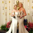 The 76th Annual Academy Awards: Reneé Zelwegger and Charlize Theron pose with their Oscar statuettes in 2004 - Press Room - 308 x 400