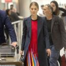 Rosamund Pike – Arrives at Heathrow Airport in London - 454 x 733