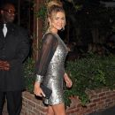 Carmen Electra seen wearing a short silver dress while leaving from a evening partying with friends at the Pink Taco in Hollywood
