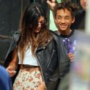 Jaden Smith puts his arms around Kylie Jenner and shows her an item while shopping together at Crystalarium on Tuesday (November 19) in West Hollywood, Calif - 454 x 599
