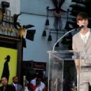 Justin Bieber appears at the Michael Jackson Hand and Footprint ceremony at Grauman's Chinese Theatre on January 26, 2012 in Los Angeles