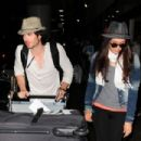 Nina Dobrev landed at Los Angeles International Airport, July 5, with her boyfriend, Ian Somerhalder. The couple were seen heading to their ride with their baggage