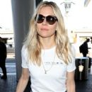 Sienna Miller at LAX Airport in Los Angeles - 454 x 681