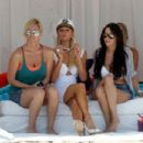 Paris Hilton wears a tight white dress with matching heels and a captains hat as she hosts a July 4th beach party at her Malibu home  (Paris Hilton)