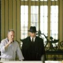 Director Michael Mann with Johnny Depp on the set of Public Enemies.