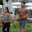 C.M. Punk and AJ Lee jogging together in June 2014 - 446 x 594