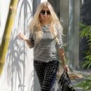Fergie is spotted leaving her home and catching a limo ride in Brentwood, California on October 6, 2015