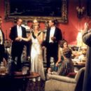The guests [from left to right: Lord Rupert Standish (Laurence Fox), Ivor Novello (Jeremy Northam), Lord Stockbridge (Charles Dance), Lady Sylvia McCordle (Kristin Scott Thomas), Hon. Freddie Nesbit (James Wilby), Mabel Nesbit (Claudie Blakley), and Conta