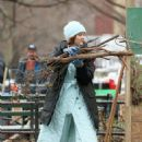 Zoey Deutch Wearing a baby blue full-length quilted coat on 'The Politician' set in NYC