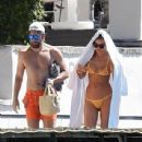 PICTURE EXCLUSIVE: Irina Shayk struggles to contain her perky assets in a skimpy yellow bikini as she cosies up to handsome beau Bradley Cooper on romantic getaway to Lake Garda - 308 x 348