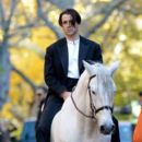 Colin Farrell rides a horse on the set of Winter's Tale