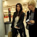 Kim Kardashian: arrives on a flight at Miami