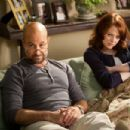 Stanley Tucci as Olive's father 'Dill' and Emma Stone as 'Olive Penderghast' in Screen Gems' EASY A.  Photo By: Adam Taylor