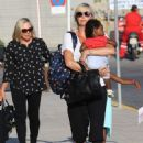 Charlize Theron- at a Cretan airport with her kids August 2016 - 454 x 617