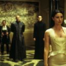 Monica Bellucci with, in the background, (l-r:) Carrie Anne-Moss, Randall Duk Kim, Laurence Fishburne and Keanu Reeves in Warner Bros. Pictures and Village Roadshow Pictures provocative futuristic action thriller 'The Matrix Reloaded,' distributed