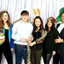Jingle Ball 2013... with his wife Lisa, and the couple's two daughters and son. The whole group celebrated by wearing holiday hats and reindeer antlers l