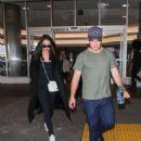 Chloe Bridges and Adam DeVine at Los Angeles International Airport in LA - 454 x 605