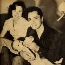 John Derek and Pati Behrs with son Russell - 454 x 561