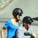 George Clooney and Stacy Keibler riding around on a scooter in Switzerland (July 12)