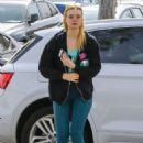 Elle Fanning in Blue Tights – Hits the gym in LA