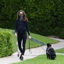 Troian Bellisario – Out for a walk with her dog in Los Angeles - 454 x 469