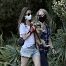 Lily Collins – Taking her beloved dog Redford for a walk in Beverly Hills