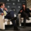 Will Lewis, CEO Dow Jones Company Inc (L) and musician Dave Grohl speak on stage during the WSJ Disruption Dinner on September 29, 2014 in New York City