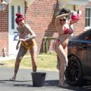 Jemma Lucy and Laura Alicia Summers in Bikini – Car Washing in Manchester - 454 x 426