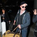 Robert Pattinson Leaves Berlin Arrives at LAX February 18, 2012