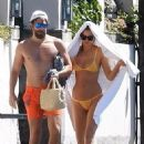 PICTURE EXCLUSIVE: Irina Shayk struggles to contain her perky assets in a skimpy yellow bikini as she cosies up to handsome beau Bradley Cooper on romantic getaway to Lake Garda - 454 x 625