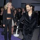 Rebecca Romijn and John Stamos attends The 1997 MTV Movie Awards