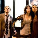 "(Left to right) Rob (Michael Stahl-David), Marlena (Lizzy Caplan) and Lily (Jessica Lucas) are on the run from a terrorizing monster in ""Cloverfield."" Photo Credit: Sam Emerson. © 2008 by Paramount Pictures. All Rights Reserved. - 454 x 303"