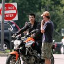 """Taylor Lautner hangs out on an Aprilia motorcycle before shooting a scene for his latest film """"Abduction"""", shooting in Pittsburgh, Pennsylvania"""