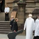 Angus Young at the funeral service for AC/DC co-founder Malcolm Young at St Mary's Cathedral on November 28, 2017 in Sydney, Australia - 454 x 303