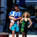 Shakira and her family on a beach in Ibiza, Spain
