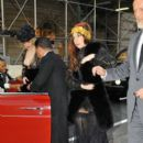 Lady GaGa alerts fans and pedestrians alike of her presence during a dramtic drive through the city
