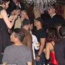 Miley Cyrus and Kellan Lutz at the grand opening of Beacher's Madhouse December 27, 2013 Las Vegas NV