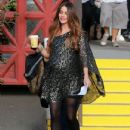Sofia Vergara gives the camera a wave while on set in Long Beach, Ca November 14th, 2012
