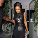 Rihanna shields her eyes from camera flashes as she leaves Il Ristorante di Giorgio Baldi - 427 x 594