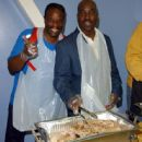 Grand L Bush and fellow actor Clifton Powell help the Mark Wahlberg Youth Foundation serve 600 dinners to at-risk youth and their families