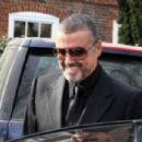 George Michael and partner Fadi Fawaz are seen leaving there home - 454 x 303