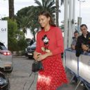 Irina Shayk in Red Dress – Leaving her hotel in Cannes