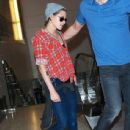 Kristen Stewart departing on a flight at LAX airport in Los Angeles, California on April 5, 2015