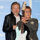 Robert Plant and Roger Daltrey pose at a press conference to announce the Daltrey/Townsend Teen & Young Adult Cancer Program at UCLA on November 4, 2011 in Los Angeles, California - 454 x 549