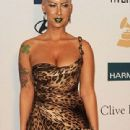 Amber Rose and Wiz Khalifa  arrive at Clive Davis and the Recording Academy's 2012 Pre-GRAMMY Gala and Salute to Industry Icons Honoring Richard Branson held at The Beverly Hilton Hotel in Beverly Hills, California - February 11, 2012 - 310 x 717
