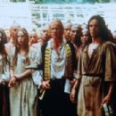 Daniel Day-Lewis as Hawkeye ( Natahaniel Poe) , Madeleine Stowe as Cora Munro, Steven Waddington as Maj. Duncan Heyward and Jodhi May as Alice Munro in The Last of The Mohicans (1992)