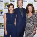 In the navy! Doctor Who co-stars Jenna Coleman and Peter Capaldi make a stand in matching blue outfits at Comic-Con